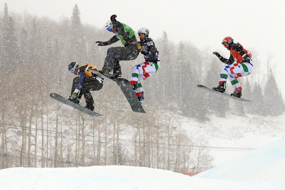. (L-R) Michael Haemmerle of Austria, Tony Ramoin of France, Luca Matteotti of Italy and Tomaso Leoni of Italy battle for position in mid air during their semi final heat in the USANA Snowboardcross World Cup Team Event on December 15, 2012 in Telluride, Colorado. Leoni and teammate Emanuel Perathoner finished second overall and Haemmerle and teammate Hanno Douschan finished third.  (Photo by Doug Pensinger/Getty Images)