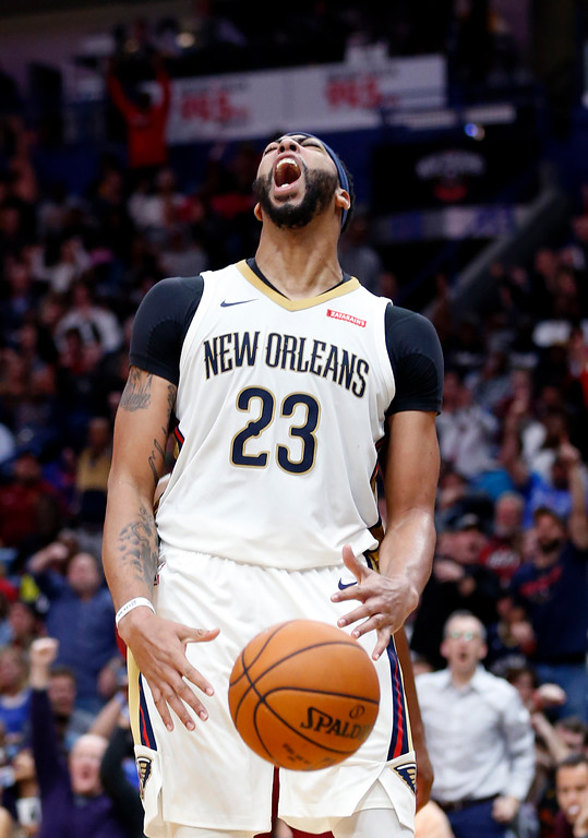 . New Orleans Pelicans forward Anthony Davis (23) reacts after his slam dunk in the second half of an NBA basketball game against the Cleveland Cavaliers in New Orleans, Saturday, Oct. 28, 2017. The Pelicans won 123-101. (AP Photo/Gerald Herbert)