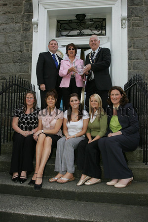 Mayor ichael Cole and Cllr Jackie Patterson present Agnes McCourt with a crystal bowl to celebrate 35years of her Business Unislim. Also pictured are, Catherine Quinn, Cathy McGhee, Natasha Rice, Aisleen Jennings and Fiona Loughran. 07W37N31