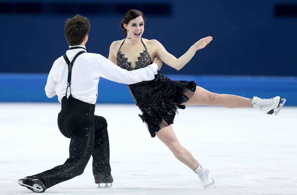 . Tessa Virtue and Scott Moir of Canada compete during the Figure Skating Ice Dance Short Dance on day 9 of the Sochi 2014 Winter Olympics at Iceberg Skating Palace on February 16, 2014 in Sochi, Russia.  (Photo by Matthew Stockman/Getty Images)