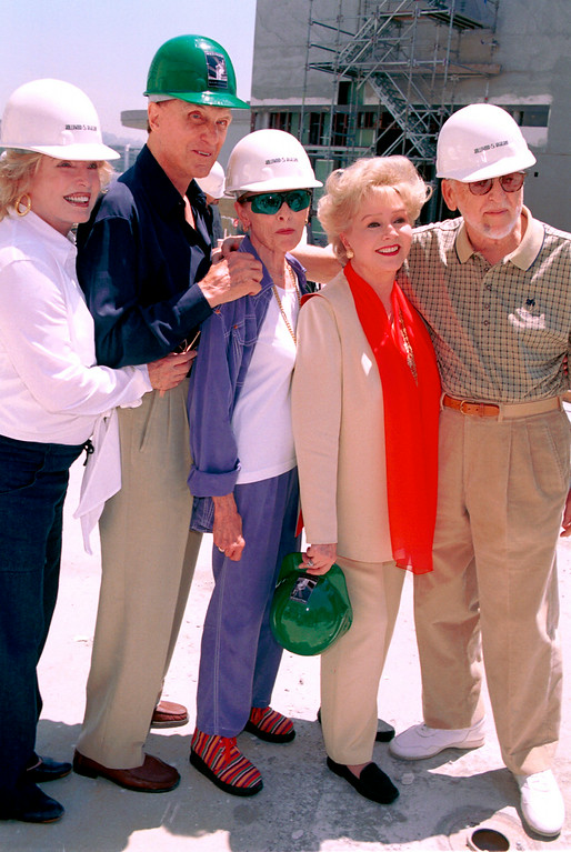 . From left to right, Rosemary Stack, Robert Stack, Janet Leigh, Debbie Reynolds and David Wolper pose for photographers at the site unveiling of the new Hollywood Motion Picture Museum June 19, 2001 in Hollywood, CA.  (Photo by Getty Images)