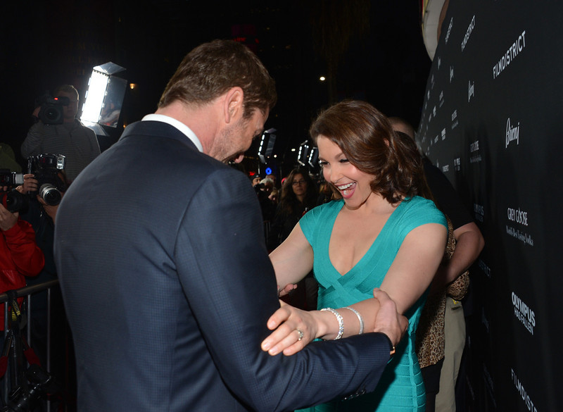 """. Actors Gerard Butler (L) and Ashley Judd arrive at the premiere of FilmDistrict\'s \""""Olympus Has Fallen\"""" at ArcLight Cinemas Cinerama Dome on March 18, 2013 in Hollywood, California.  (Photo by Alberto E. Rodriguez/Getty Images)"""