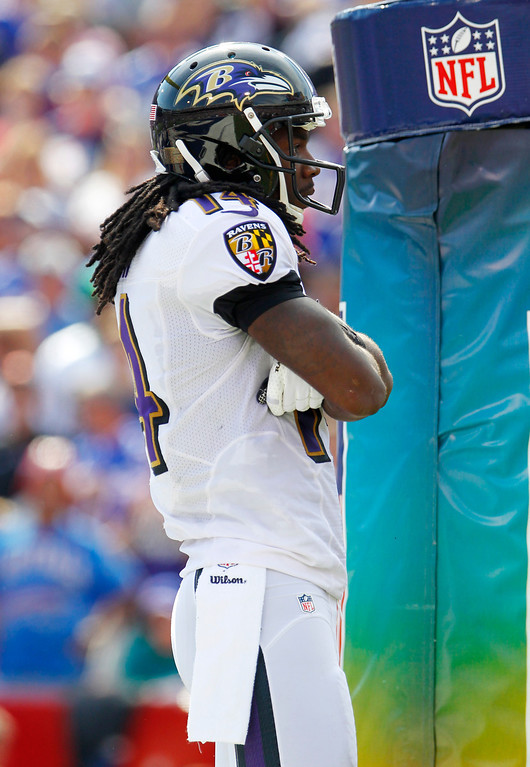 . Baltimore Ravens wide receiver Marlon Brown (14) looks to the stands after scoring a touchdown against the Buffalo Bills during the first half of an NFL football game on Sunday, Sept. 29, 2013, in Orchard Park, N.Y. (AP Photo/Bill Wippert)