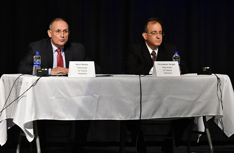 10/23/2018 Mike Orazzi   Staff Henri Martin and Christopher Wright during The Bristol Chamber of Commerce's Senate and House forum at St. Paul Catholic High School Tuesday night.