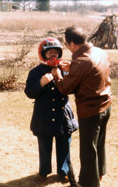 Uncle Bud helping Aunt Gladys with helmet.JPG
