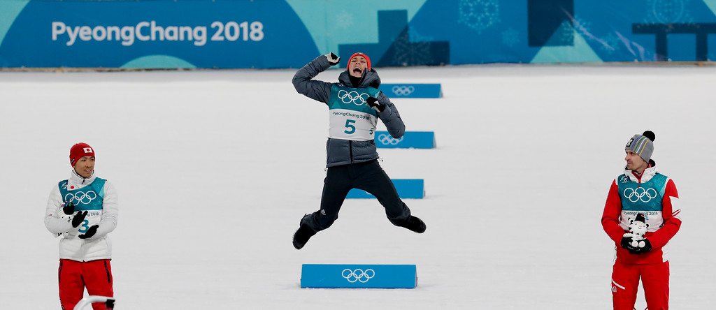 . Gold medal winner Eric Frenzel, of Germany, is flanked by silver medal winner Akito Watabe, of Japan, left, and bronze medal winner Lukas Klapfer, of Austria, during the Venue Ceremony after the 10km cross-country skiing portion of the nordic combined event at the 2018 Winter Olympics in Pyeongchang, South Korea, Wednesday, Feb. 14, 2018. (AP Photo/Dmitri Lovetsky)