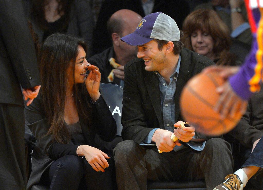 . Actors Mila Kunis and Ashton Kutcher talk prior to the Los Angeles Lakers\' NBA basketball game against the Utah Jazz, Friday, Jan. 3, 2014, in Los Angeles. (AP Photo/Mark J. Terrill)
