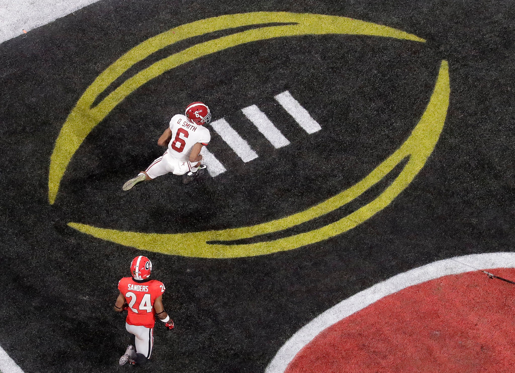 . Alabama\'s DeVonta Smith catches a touchdown pass during overtime of the NCAA college football playoff championship game against Georgia Monday, Jan. 8, 2018, in Atlanta. Alabama won 26-23. (AP Photo/John Bazemore)