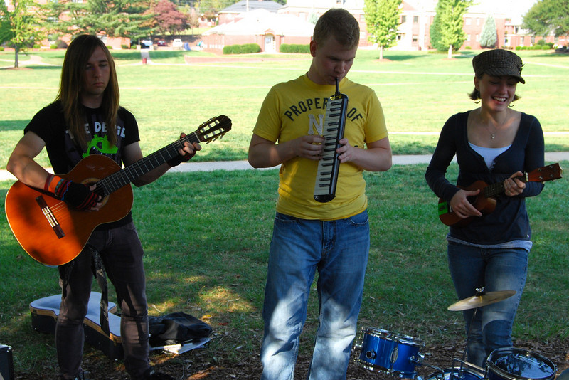 Students hang out on the quad and have a mini concert with mini intsruments.