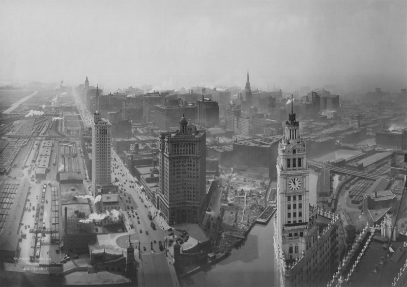 This photograph was probably taken in 1925, since the vantage point seems to be the Tribune Tower (1925). The London Guarantee and Accident Building (1923; now 360 North Michigan Avenue), and both the Wrigley Building (1921) and its Annex (1924) are completed, while Wacker Drive, which opened in 1926, is under construction. Grant Park is still largely undeveloped. Illinois Central facilities dominate the area south of the river and east of the buildings that line the east side of a widened Michigan Avenue.  Photographer: Kaufmann & Fabry Source: Chicago Historical Society (ICHi-51173)   http://encyclopedia.chicagohistory.org/pages/10405.html