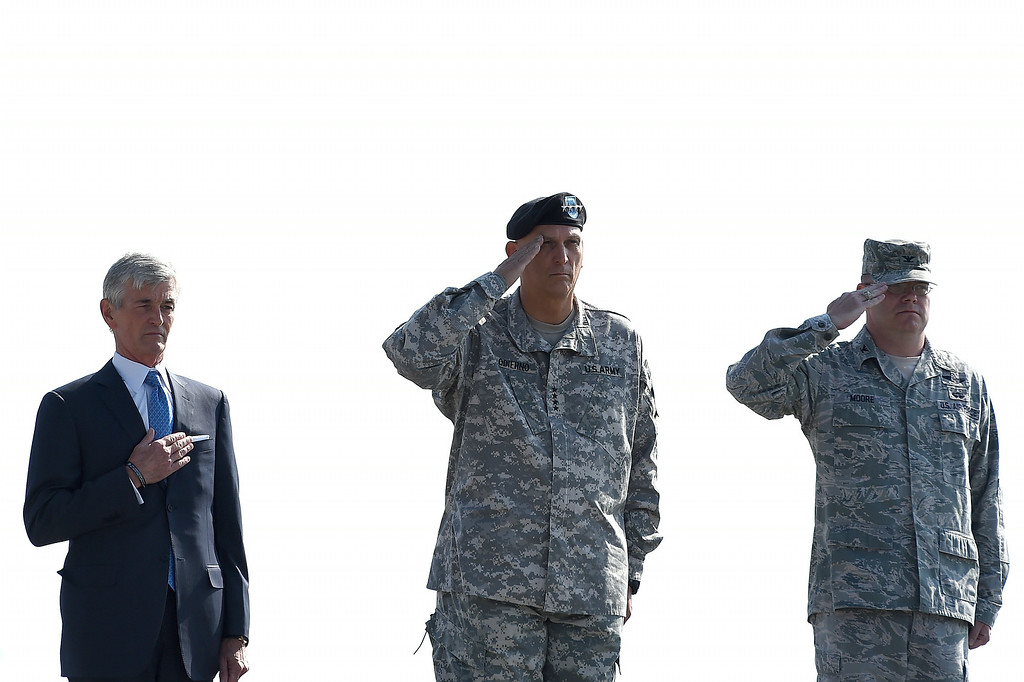 . U.S. Army Secretary John McHugh (L) holds his hand over his heart as U.S. Army Chief of Staff Ray Odierno (C), and Dignified Transfer Host, U.S Air Force Col. Richard G. Moore salute, during the dignified transfer of the remains of U.S. Army Maj. Gen. Harold J. Greene at Dover Air Force Base on August 7, 2014 in Dover, Delaware.  (Photo by Patrick Smith/Getty Images)