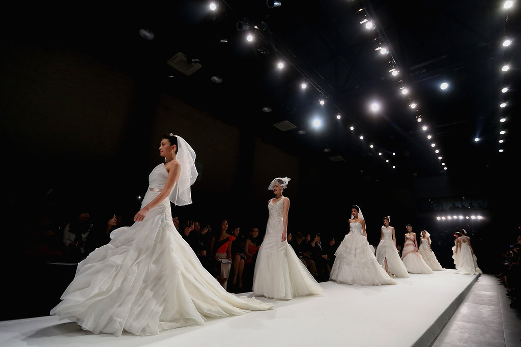 . Models showcase designs at ALLWHITE Peng Jing Wedding Dress Collection show during Mercedes-Benz China Fashion Week Spring/Summer 2014 at 751 D-PARK Workshop on October 27, 2013 in Beijing, China.  (Photo by Feng Li/Getty Images)