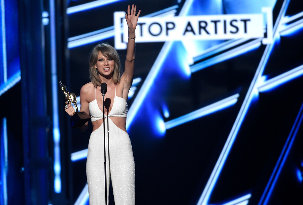 . Taylor Swift accepts the award for top artist at the Billboard Music Awards at the MGM Grand Garden Arena on Sunday, May 17, 2015, in Las Vegas. (Photo by Chris Pizzello/Invision/AP)
