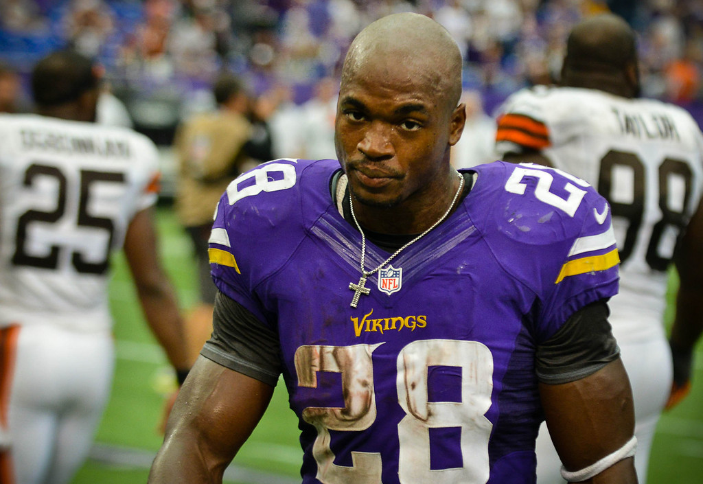 . Vikings running back Adrian Peterson heads off the field after Minnesota\'s 31-27 loss to the Browns.  (Pioneer Press: Ben Garvin)