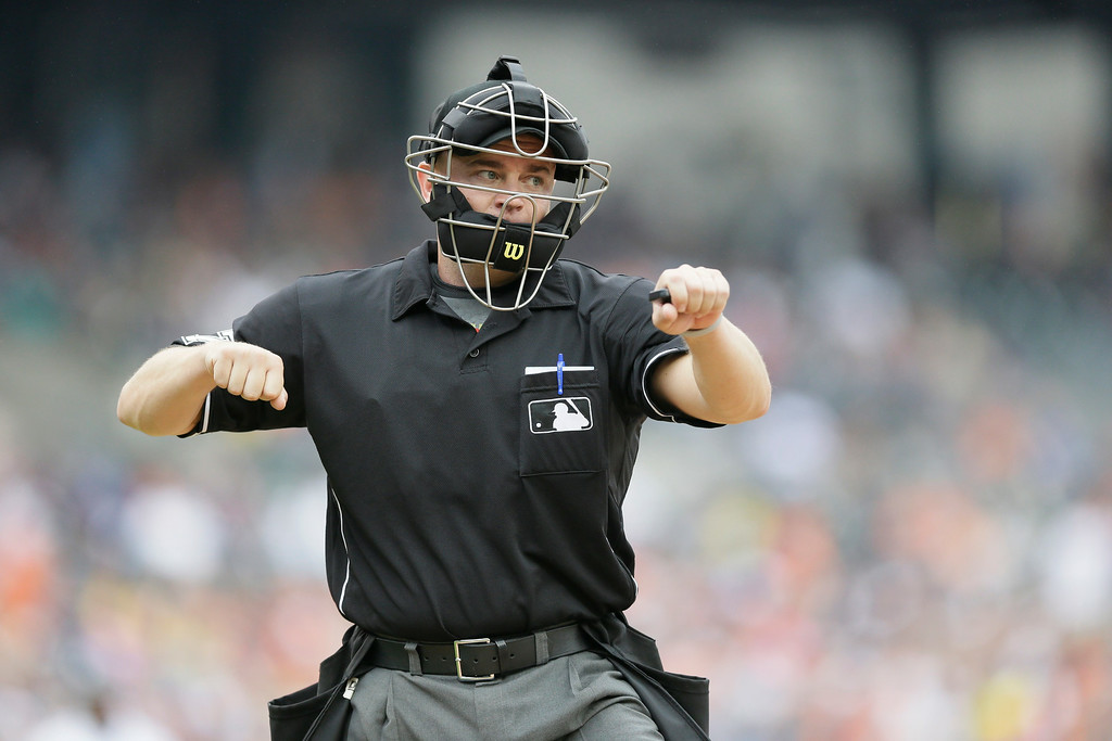 . Homeplate umpire Scott Barry signals an out during the seventh inning in the first baseball game of a doubleheader between the Detroit Tigers and the Cleveland Indians, Saturday, July 19, 2014 in Detroit. (AP Photo/Carlos Osorio)