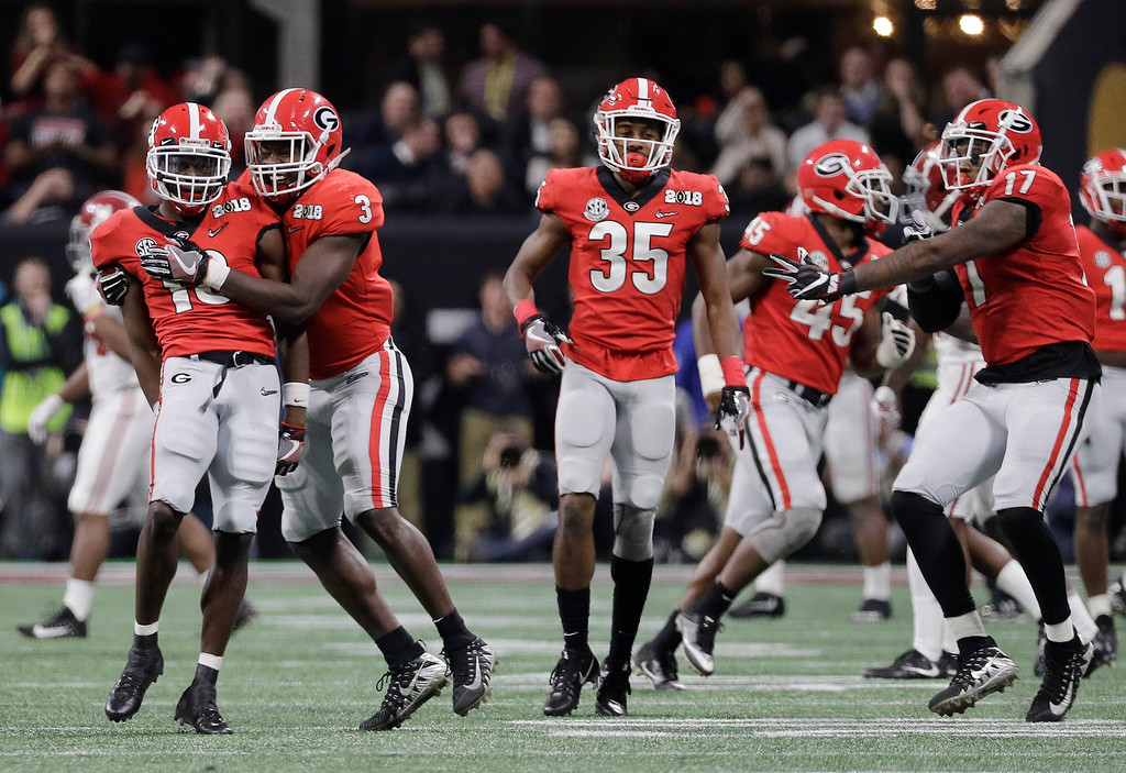 . Georgia\'s Deandre Baker is congratulated after intercepting a pass during the second half of the NCAA college football playoff championship game against Alabama Monday, Jan. 8, 2018, in Atlanta. (AP Photo/David J. Phillip)