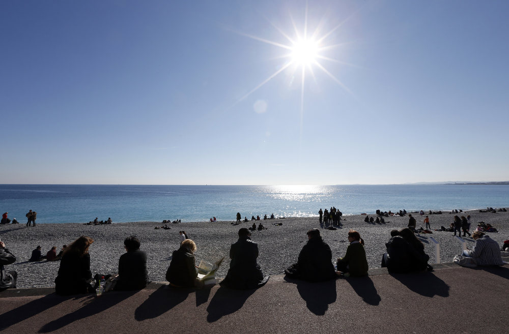 . People catch some rays of sun on the Mediterranean sea on February 16, 2013 in the southeastern French city of Nice.  VALERY HACHE/AFP/Getty Images