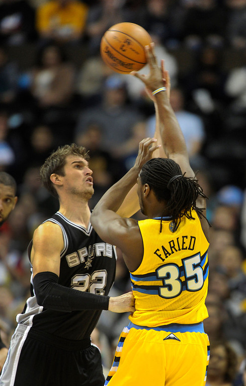 . San Antonio center Tiago Splitter (22) tried to block a pass from Denver\'s Kennth Faried (35) n the first half. The Denver Nuggets hosted the San Antonio Spurs at the Pepsi Center Tuesday night, December 18, 2012. Karl Gehring/The Denver Post