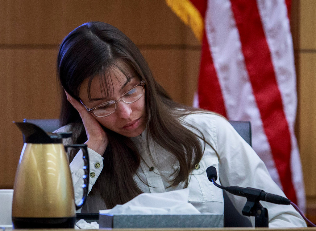 . Defendant Jodi Arias talks about the text messages with Travis Alexander from March through May 2008, as she testifies in her murder trial st Judge Sherry Stephens\' Superior Court , on Tuesday, Feb. 19, 2013.  Arias is charged in the 2008 stabbing and shooting death of her lover, Alexander.  She faces the death penalty if convicted of first-degree murder.  (AP Photo/The Arizona Republic, Charlie Leight, Pool)