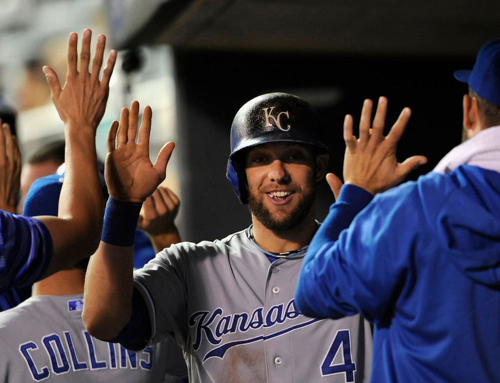. Alex Gordon #4 of the Kansas City Royals celebrates scoring a run against the Minnesota Twins during the ninth inning. (Photo by Hannah Foslien/Getty Images)