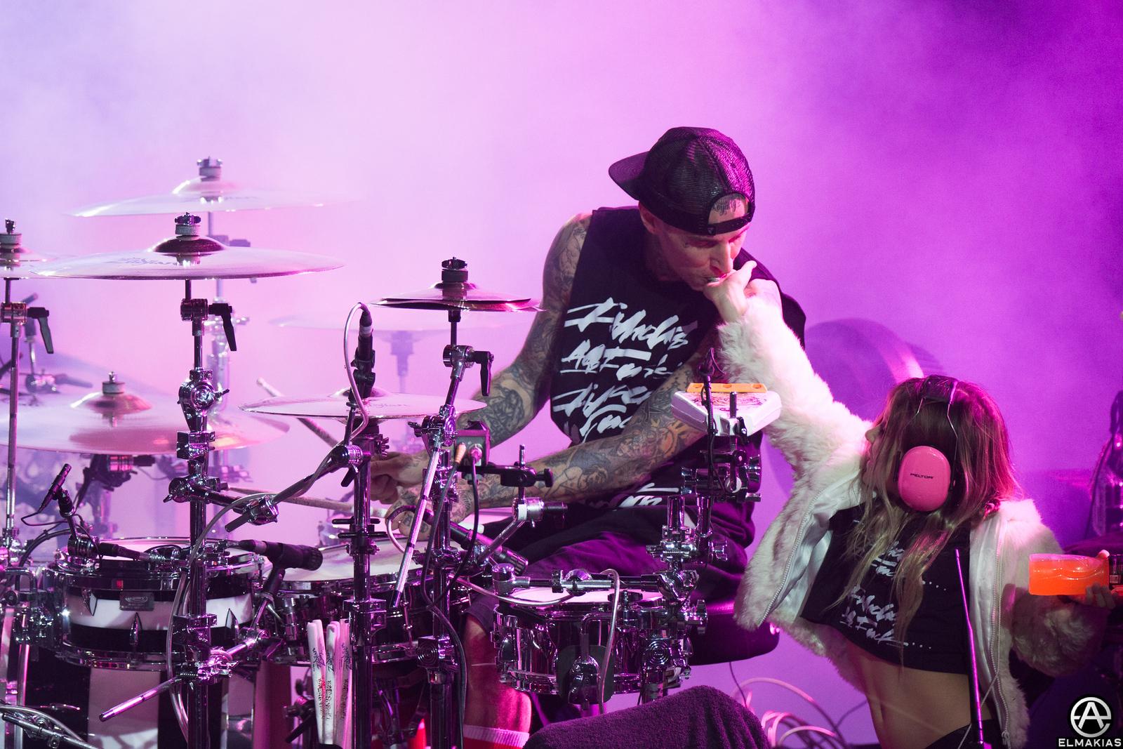 Travis Barker of Blink-182 at Leeds Festival, his daughter giving him some candy, midset