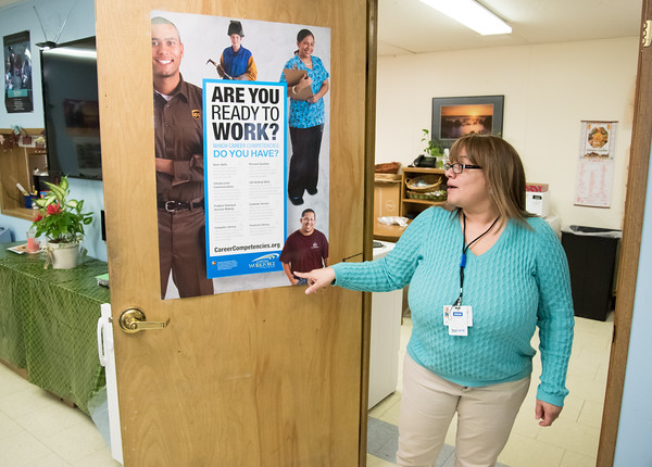 04/11/18 Wesley Bunnell | Staff Director of Youth Services for HRA of new Britain Summer Youth Employment and Learning Program, Leticia Mangual, stands next to a poster addressing skills needed in the workforce. The program which is located at 58 Scarlett St. helps prepare high school students with training and work experience.