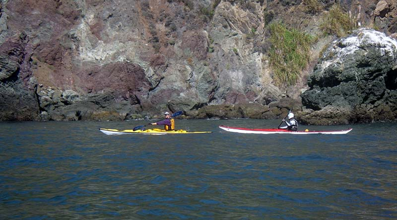 Ediko and Dave head toward Bonita Cove with a backdrop of Doerte's geological study.