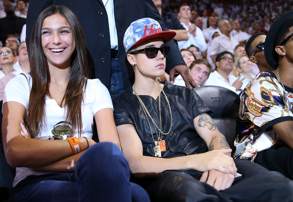. MIAMI, FL - JUNE 03:  Singer Justin Bieber sits courtside as he watches the Miami Heat host the Indiana Pacers during Game Seven of the Eastern Conference Finals of the 2013 NBA Playoffs at AmericanAirlines Arena on June 3, 2013 in Miami, Florida.  (Photo by Mike Ehrmann/Getty Images)