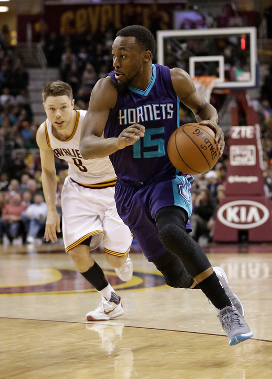 . Charlotte Hornets\' Kemba Walker (15) drives to the basket as Cleveland Cavaliers\' Matthew Dellavedova (8), from Australia, watches in the second half of an NBA basketball game Wednesday, Feb. 24, 2016, in Cleveland. The Cavaliers won 114-103. (AP Photo/Tony Dejak)