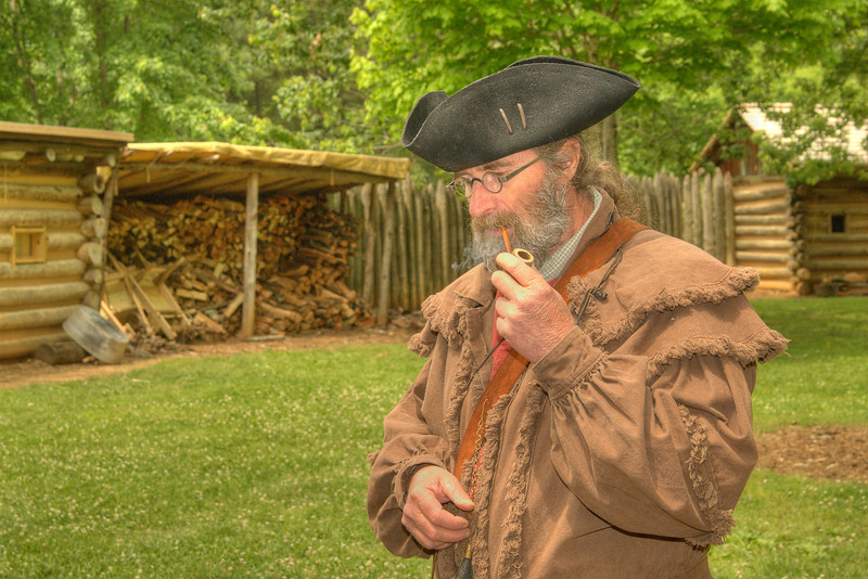 A reenactor inside the recreation of Fort Watauga during the Siege of Fort Watauga at Sycamore Shoals State Park in Elizabethton, VA on Saturday, May 17, 2014. Copyright 2014 Jason Barnette  The Siege of Fort Watauga is a two-day reenactment held each year at the recreation of the fort inside Sycamore Shoals State Historic Park. The reenactment brings in dozens of reenactors and hundreds of visitors as they tell the story of an attack on the early settlers village by Dragging Canoe, and how they successfully defended themselves. During the reenactment, the fort is open to the public with demonstrations of all areas of early settler life on the frontiers.
