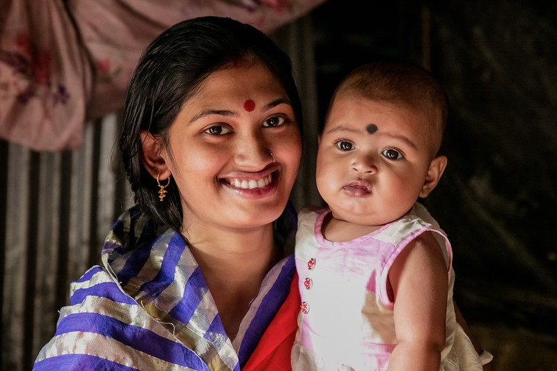 0085-0093A village mother Songita Rani (20) posing for photographs with her 6-month-old baby Anusree.Atkhali Village, Dakua Union Golachepa, Potuakhali. Bangladesh.Photo Credit: b.a.sujaN / Map / WRA