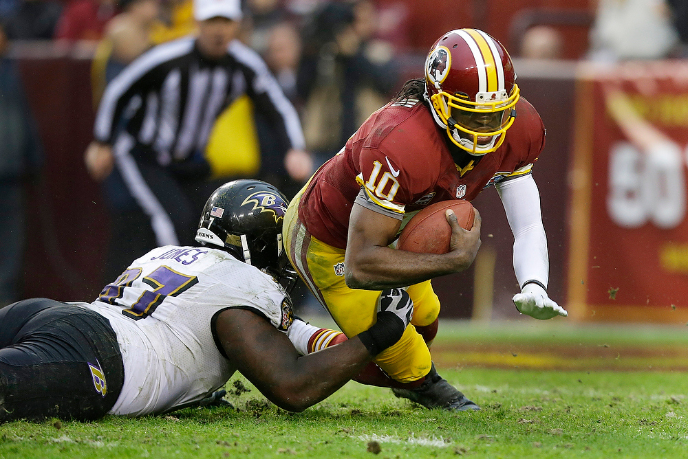 . Baltimore Ravens defensive end Arthur Jones sacks Washington Redskins quarterback Robert Griffin III during the second half of an NFL football game in Landover, Md., Sunday, Dec. 9, 2012. (AP Photo/Alex Brandon)