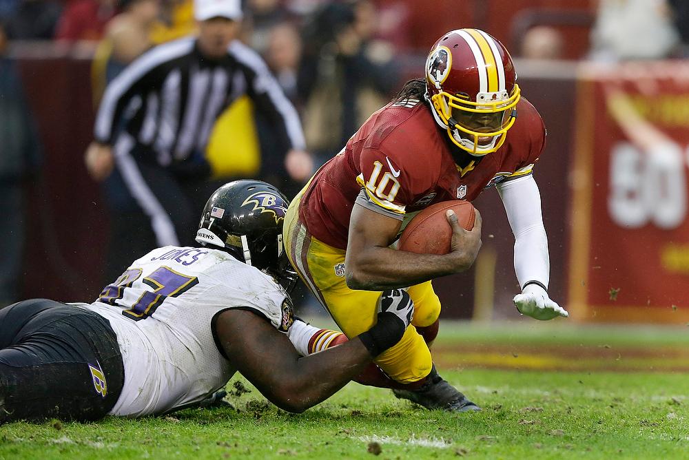 Description of . Baltimore Ravens defensive end Arthur Jones sacks Washington Redskins quarterback Robert Griffin III during the second half of an NFL football game in Landover, Md., Sunday, Dec. 9, 2012. (AP Photo/Alex Brandon)