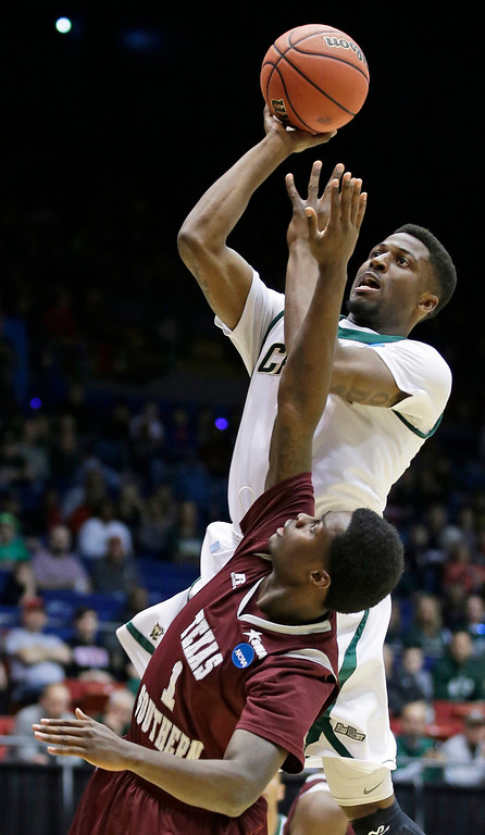 . Cal Poly guard Dave Nwaba, top, shoots over Texas Southern guard D.D. Scarver (1) in the first half of a first-round game of the NCAA college basketball tournament on Wednesday, March 19, 2014, in Dayton, Ohio. (AP Photo/Al Behrman)