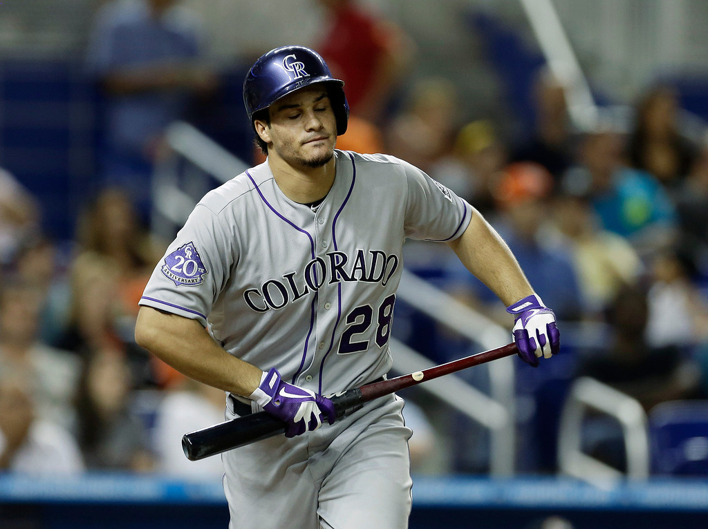 . Colorado Rockies batter Nolan Arenado (28) reacts after flying out during the second inning of a baseball game against the Miami Marlins in Miami, Saturday, Aug. 24, 2013. (AP Photo/J Pat Carter)