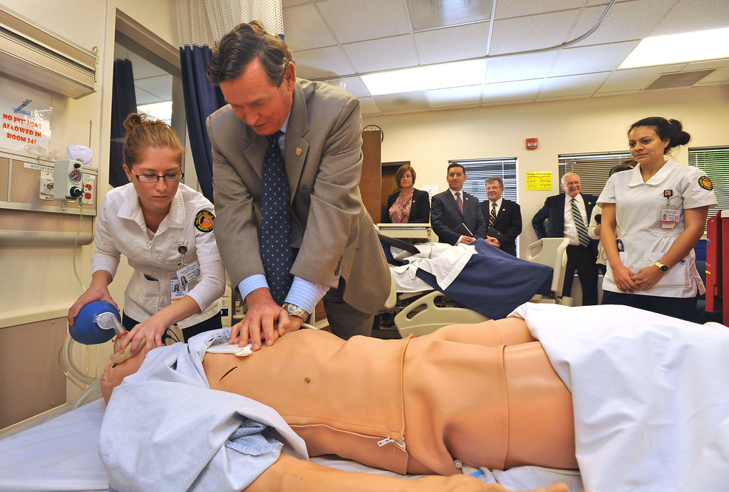 . CSU Chancellor Timothy P. White gives chest compressions to a training dummy as nursing student Takara Williams administers oxygen as White toured the nursing facility and other campus locations at Cal State Long Beach on Monday, October 14, 2013.  (Photo by Scott Varley, Daily Breeze)