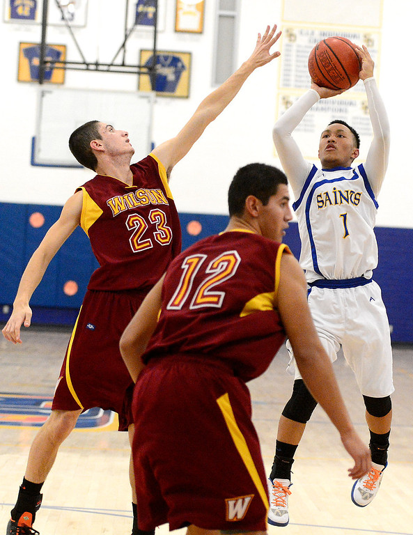 . Wilson\'s Erick Ramos (23) attempts to block San Dimas\' Ryan Ocampo (1) from making a shot as Wilson defeats San Dimas 45-43 Friday night, January 10, 2014 at San Dimas High School.  (Photo by Sarah Reingewirtz/Pasadena Star-News)