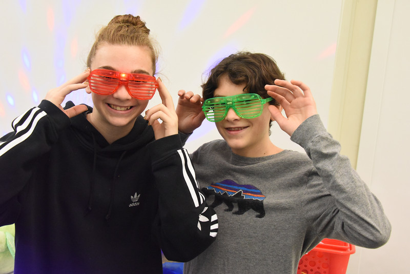 Teen library volunteers Dylan Underwood and Teresa Lewis helped as well. (Bill Giduz photo)