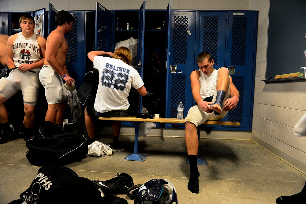 . Logan Sitzman wears a Trey Johnson Believe 22 T-shirt as he gets ready for practice with teammates on Wednesday, November 21, 2012. Players wore the shirts and bracelets in honor of their teammate who suffered a life-threatening head injury during a game about one month prior.