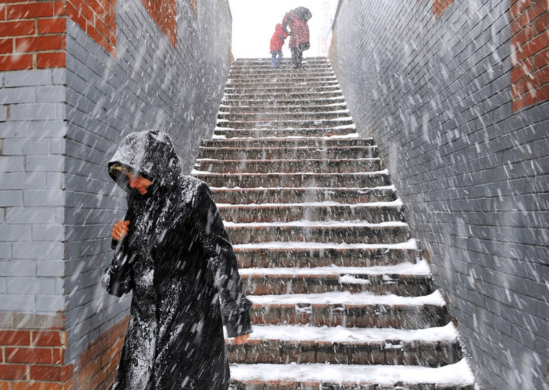 . Snow falls as people walk in downtown Istanbul on January 8, 2013. Heavy snowfall blanketed Turkey\'s commercial hub Istanbul, a city of 15 million, paralysing daily life, disrupting air traffic and land transport. Officials said the snow expected to continue until late tomorrow, according to the weather forecast. BULENT KILIC/AFP/Getty Images