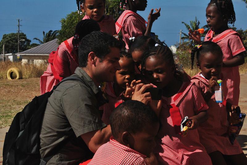 Looking at Matt's pictures, Flagaman Basic School. Photo by John Bernstein.