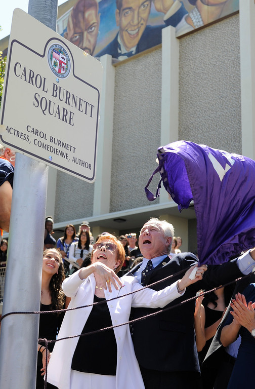 """. Carol Burnett, award-winning actress, comedienne and best-selling author, was honored by the City of Los Angeles for her lifetime achievements with the naming of Carol Burnett Square at the intersection of Highland Avenue and Selma Avenue. The Square is adjacent to Hollywood High School where Burnett attended. Students from the school choir, \""""H2O\"""" sang �I�m so glad we had this time together,� before Burnett and LA City Councilman Tom LaBonge unveiled her street sign. Hollywood, CA 4/18/2013(John McCoy/Staff Photographer"""