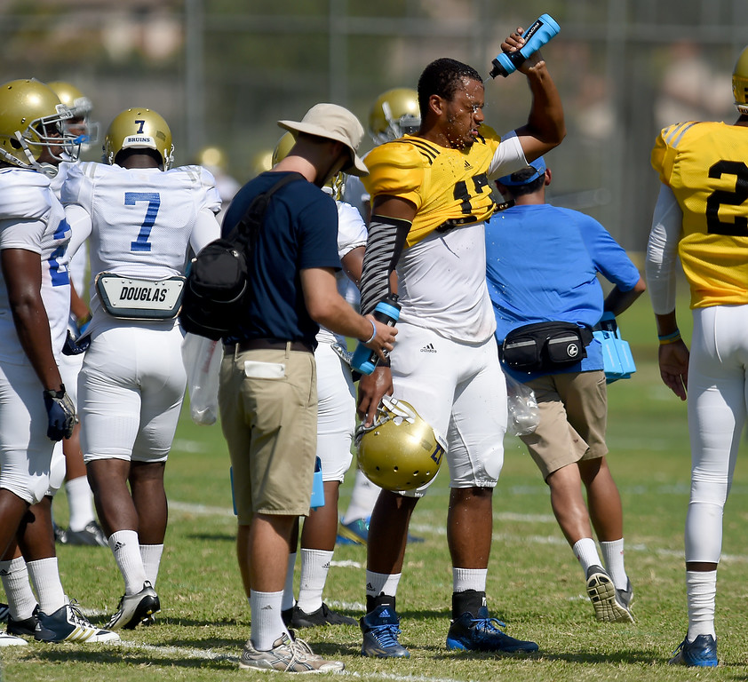 . Quarterback Brett Hundley cools off during the UCLA Bruins football practice at Cal State San Bernardino in San Bernardino, CA, Friday, August 8, 2014. (Photo by Jennifer Cappuccio Maher/Inland Valley Daily Bulletin)
