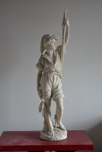 marble statue of a fisher boy