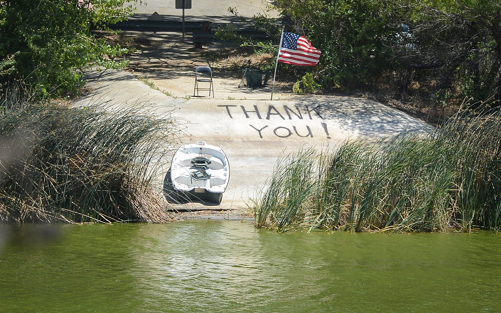 . A note to firefighters along Lake Huges where helicopters continue to pick up water to drop on the Power House fire which continued to burn in an area mort of Santa Clarita Monday.   Photo by David Crane/Los Angeles Daily News