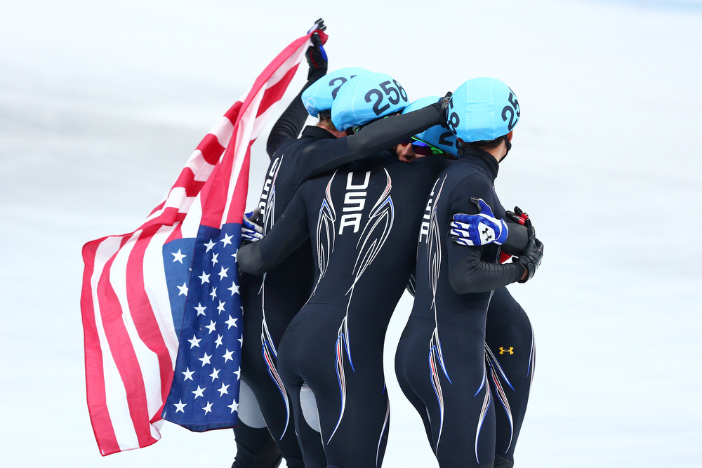 . Members of the United States short track team celebrate winning the silver medal in the Short Track Men\'s 5000m Relay on day fourteen of the 2014 Sochi Winter Olympics at Iceberg Skating Palace on February 21, 2014 in Sochi, Russia.  (Photo by Paul Gilham/Getty Images)