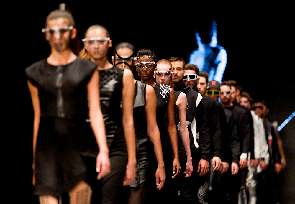 Description of . Models wear creations by Israeli designer Yosef during a show at the Tel Aviv fashion week in Tel Aviv, Israel, Tuesday, Dec. 18, 2012. (AP Photo/Ariel Schalit)