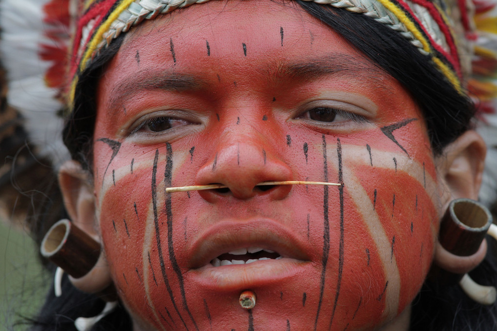 . A Pataxo Indian takes part in the first day of  the National Indigenous Mobilization protest in Brasilia, Brazil, Tuesday, Oct. 1, 2013.  (AP Photo/Eraldo Peres)