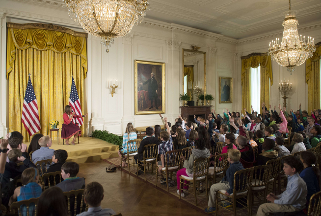 . US First Lady Michelle Obama answers questions from children of Executive Office employees at the White Houses annual Take Our Daughters and Sons to Work Day in the East Room of the White House in Washington, DC, April 24, 2014. (SAUL LOEB/AFP/Getty Images)