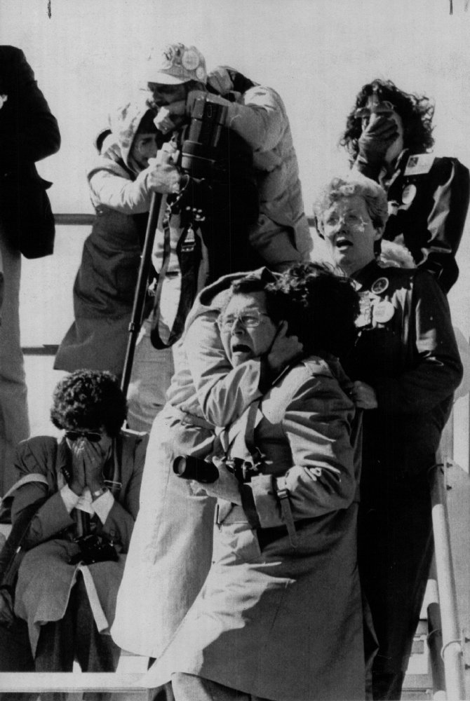 Description of . Spectators at the Kennedy Space Center VIP area react to the explosion of the Challenger on Jan. 28, 1986. The space shuttle exploded some seventy-two seconds after ignition, all aboard perished.  Denver Post Library Archive